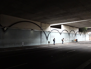 Image of 40th Street underpass adjacent to MacArthur station looking very dark and uninviting