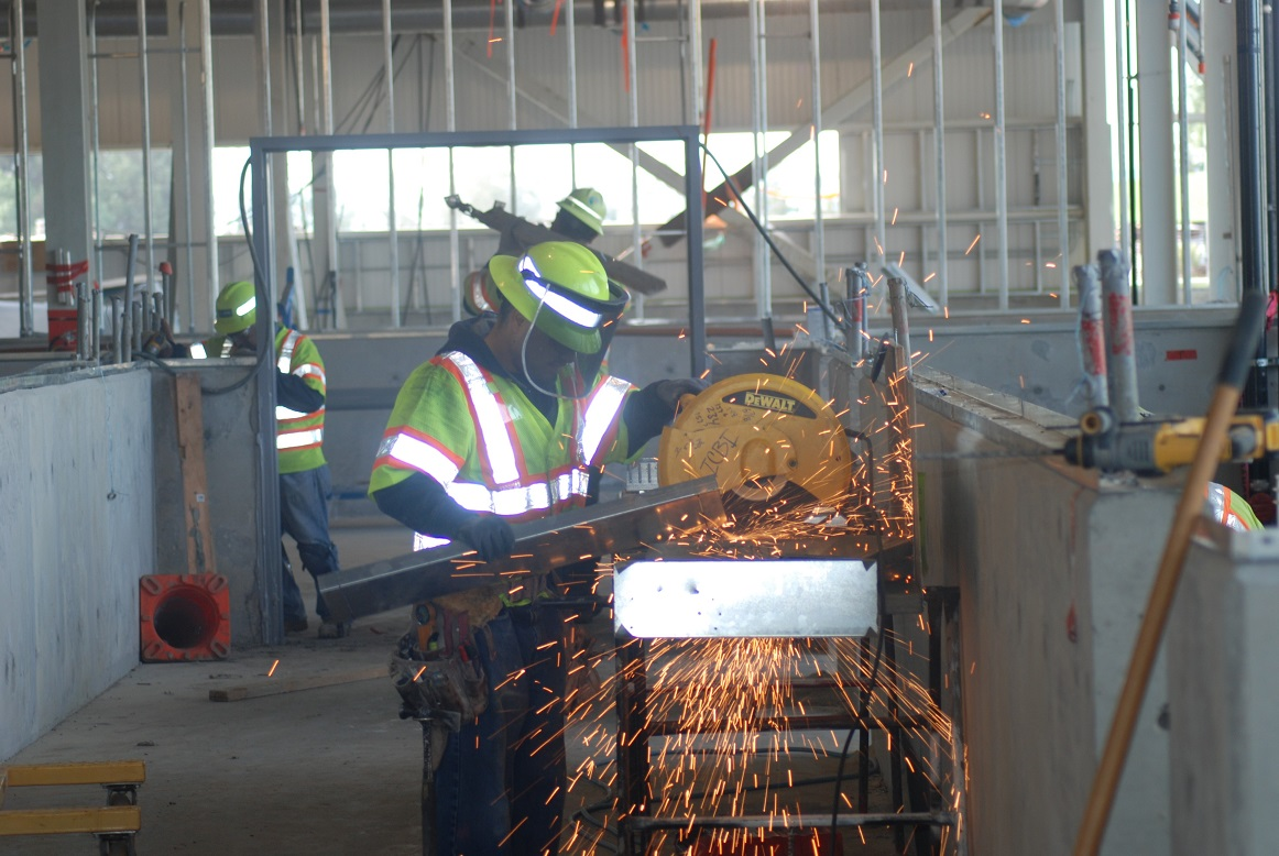 A worker uses a saw at a BART construction project