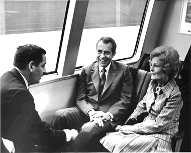 President Richard M. Nixon and his wife, Pat, take a BART ride.