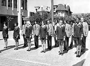Photo depicting BART officers circa 1972-1975, wearing blazers to maintain a low key appearance (officers are pictured behind civilian support personnel)