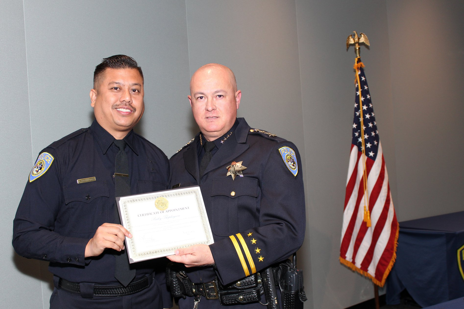 Interim Chief Ed Alvarez poses with sworn-in police officer