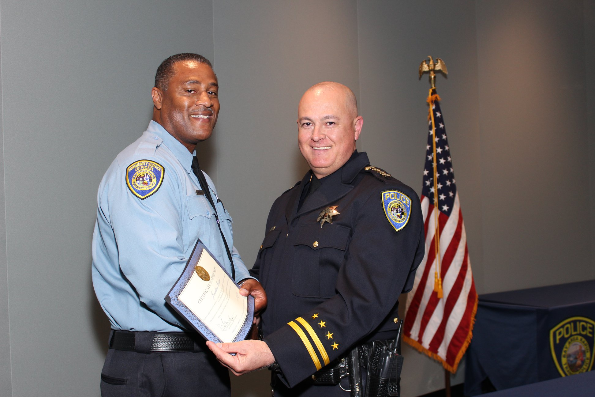 Interim Chief Ed Alvarez poses with sworn-in Community Service Officer
