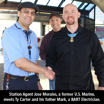 Station Agent Jose Morales, a former U.S. Marine, meets Medal of Honor recipient Ty Carter. Ty's father Mark, a BART Electrician, is seen in the background.
