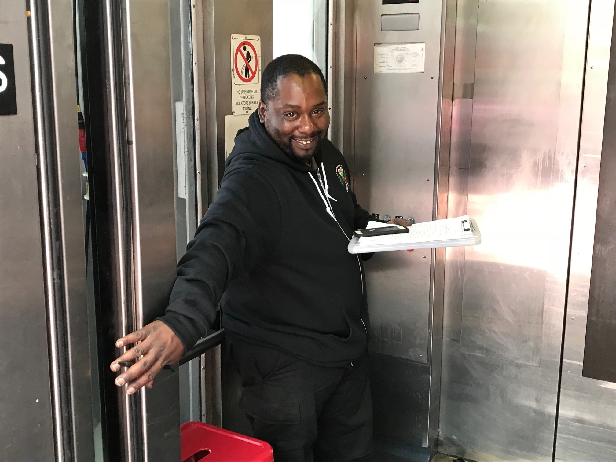 Charles Jones greets customers at the elevator