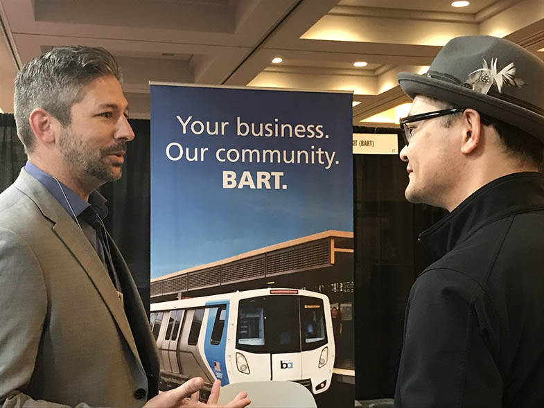 , Liu, in hat, meets one-on-one with a networking attendee at a pre-Covid event in March 2019. Photo by Melissa Jordan