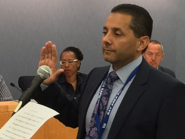 Carlos Rojas takes the oath of office