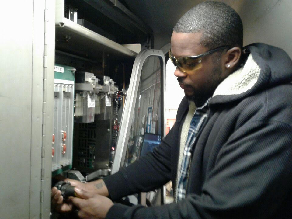 Asberry working in a train cab