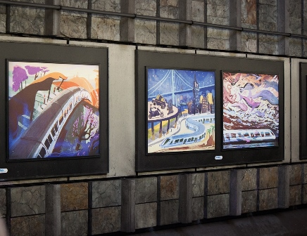 Image of the three art posters by the artist; feature a train wondering through hills, cliff escape, and bay.