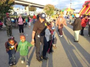 Image of BART Police officer with children at National Night Out event