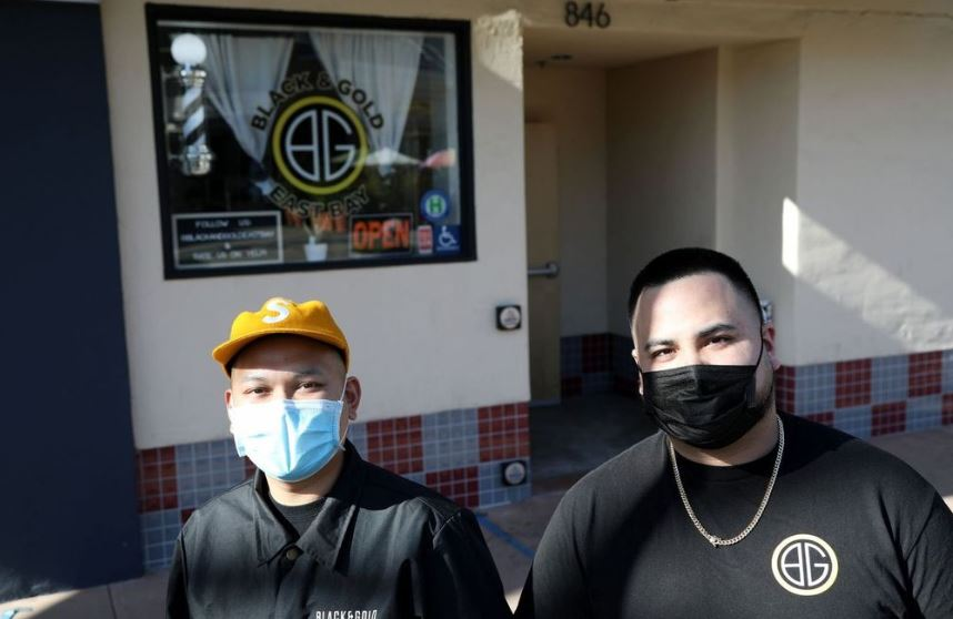 Mark DeGuzman, left, and Jamie Anabeza outside Black and Gold East Bay in Hayward