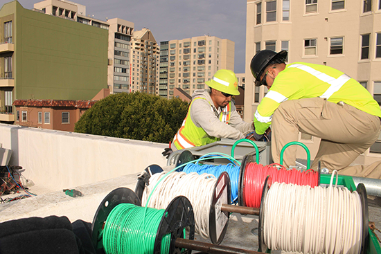 workers installing cable