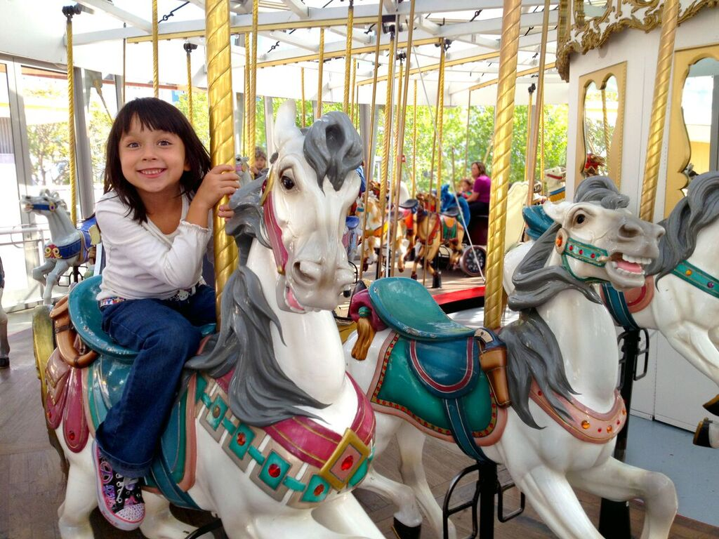 Child on carousel at Children's Creativity Museum