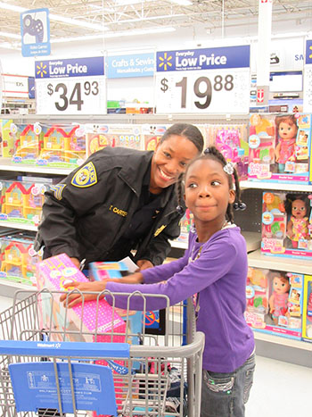 "Sgt. Carter participates in the 2015 ""Shop With A Cop"" event to help disadvantaged children during the holidays"