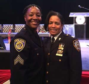 Sgt. Carter, left, with the past president of NOBLE, the Rev. Barbara Harris-Williams, who is a senior chaplain in the NYC PD