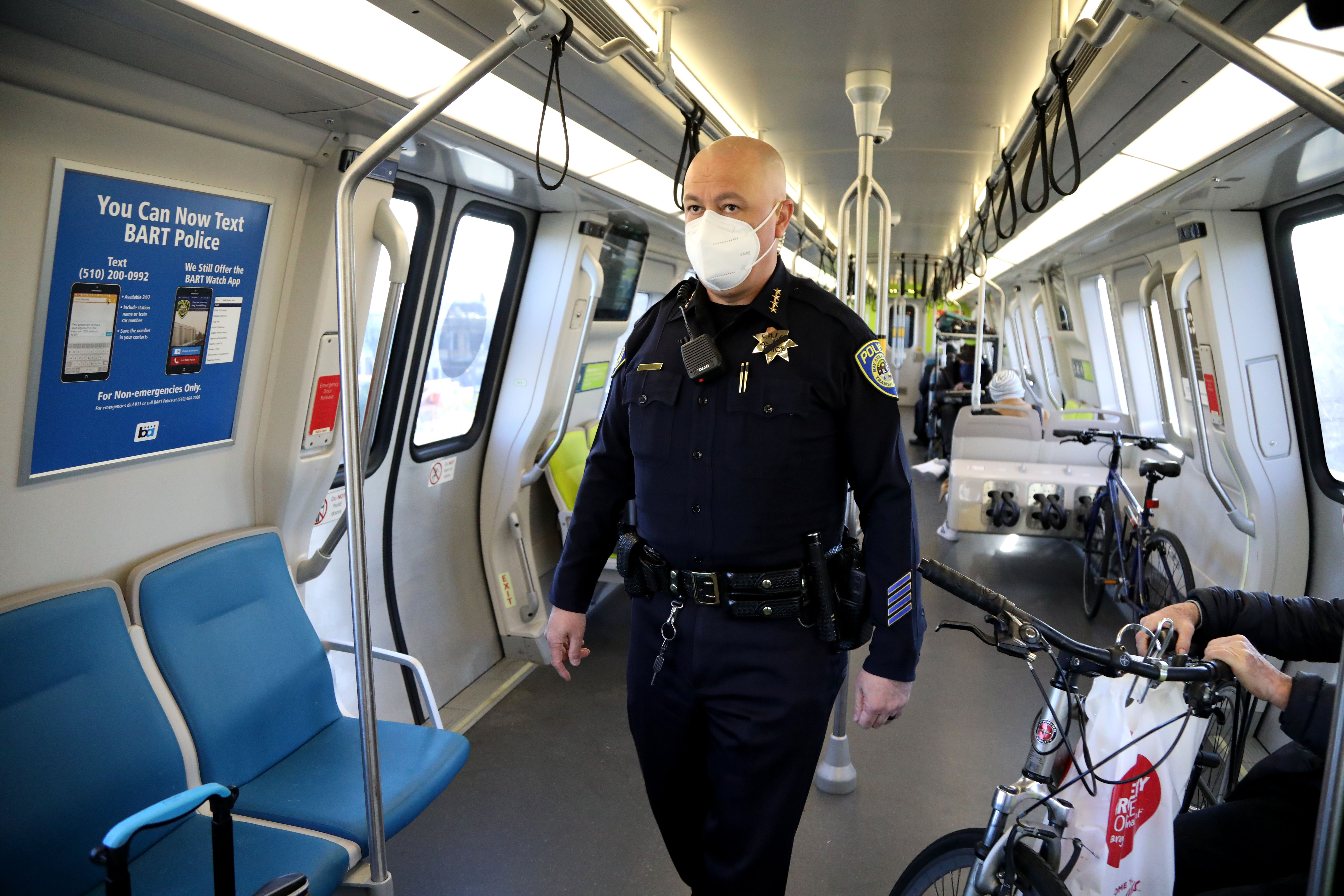 Chief Alvarez regularly walks trains to interact with passengers. Shown here on Feb. 1,  2021; note the poster at left behind bl