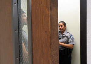 An officer role plays the perpetrator in a domestic violence case while Explorer Whitney Ibarra conducts an interview