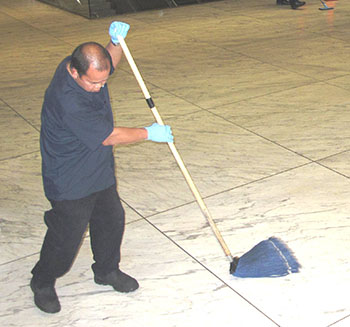 man mops station floor