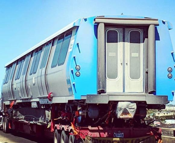 a new train car being shipped cross country