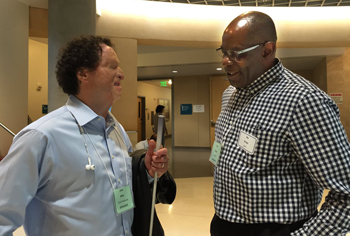 Josh Miele, left, a scientist at the Smith-Kettlewell Eye Research Institute, with BART's Dr. Ike Nnaji