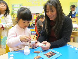 teacher Katryna Shek works with a student