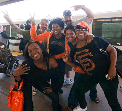 Giants fans waiting to board BART