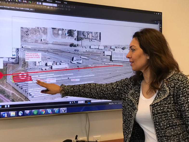 Moheb discusses a Richmond Yard Track Rehabilitation plan in a meeting with her team