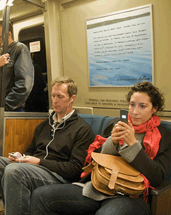 BART riders check their mobile devices on election night 2008