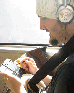 man playing portable game player on BART