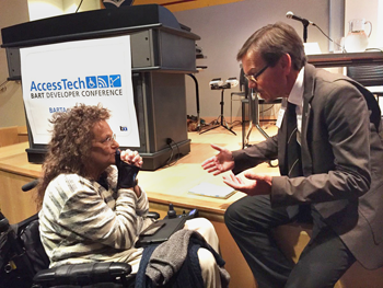 Marilyn Golden of the Disability Rights Education and Defense Fund, left, with BART Director Robert Raburn