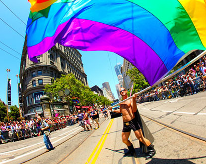 A man waves a flag at SF Pride