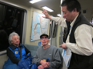 Senior citizens on BART train with tour leader