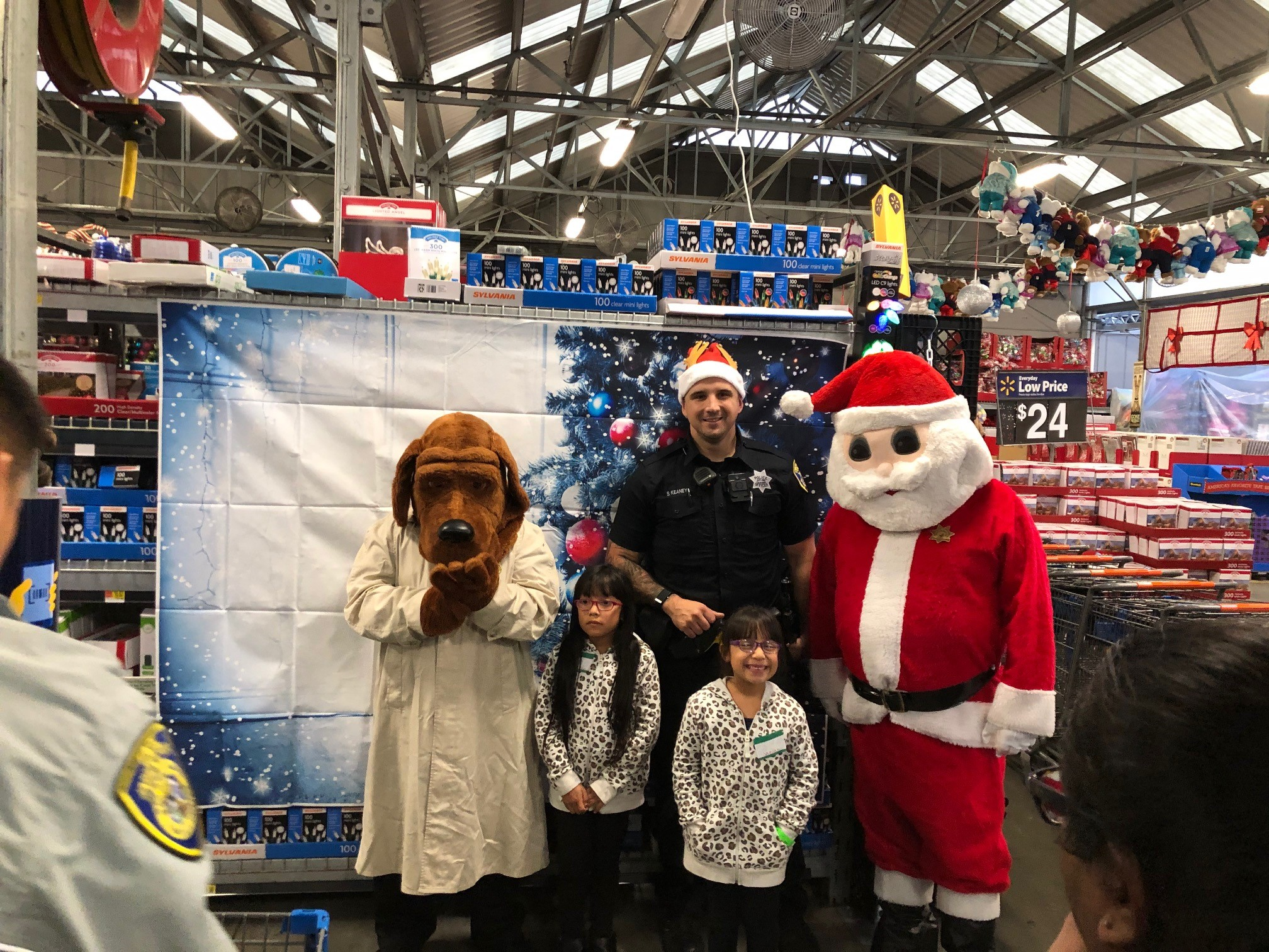 Shop with a Cop, with Santa and McGruff the Crime Dog