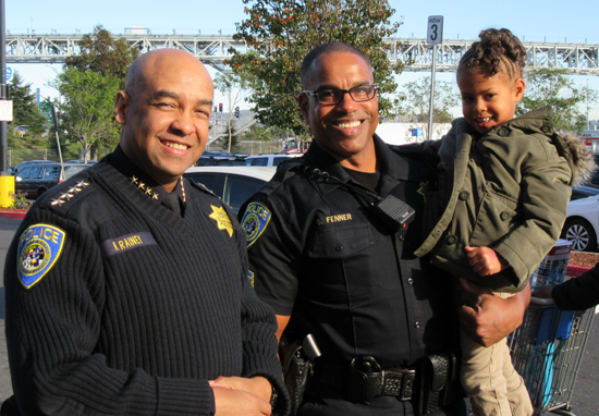 Chief Kenton Rainey, Sgt. Sean Fenner and shopper
