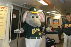 A's mascot Stomper on a BART train