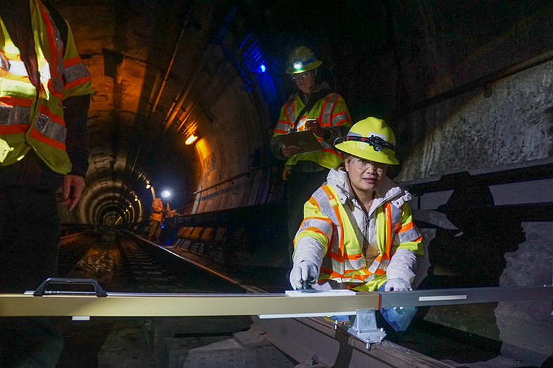 Senior Engineer Van Nguyen uses a gauge to measure fault creep in the BART Caldecott Tunnel