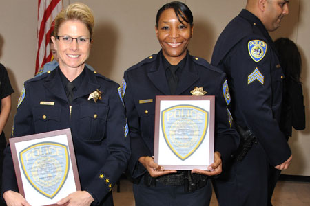 Newly promoted Sgt. Carolyn Perea and Sgt. Tanzanika Carter.