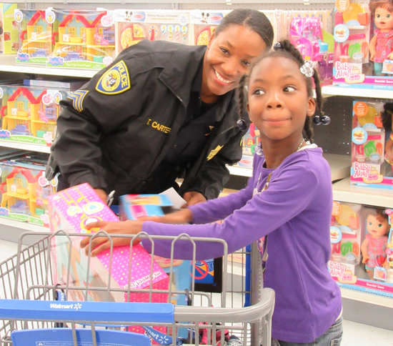 Sgt. Carter shopping with a child.