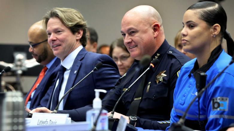 BART Police Chief Ed Alvarez, center, with BART GM Bob Powers, left, and Ambassador Lateefa Davis