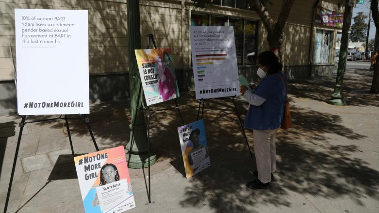 Signs at Not One More Girl's in-person event at Avenida de la Fuerte near Fruitvale Station on April 14.