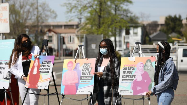 Posters for Not One More Girl are unveiled at the campaign's announcement press conference at West Oakland Station on April 2, 2
