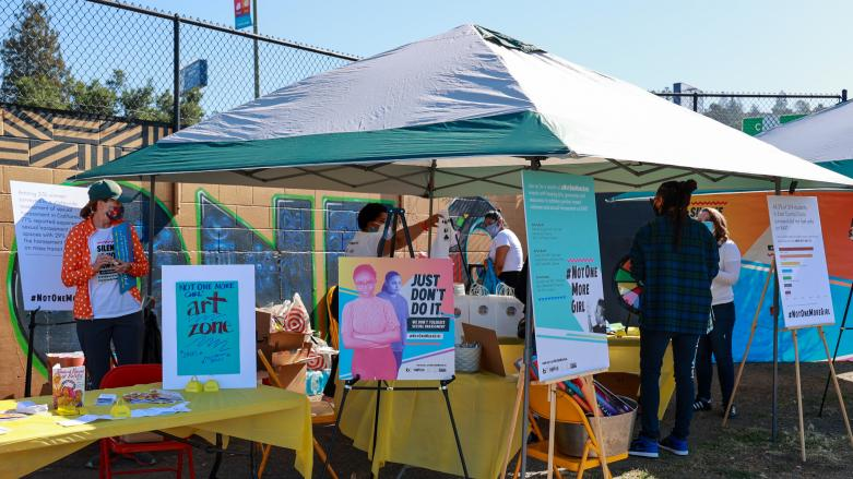 Tent set-up for Not One More Girl's in-person event at Akoma Market in Oakland on April 18. Photo: Stephen Woo