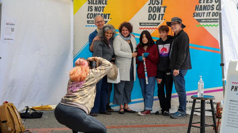 Participant pose for a photo at Not One More Girl's Art Activation event at West Oakland BART Station on April April 24.
