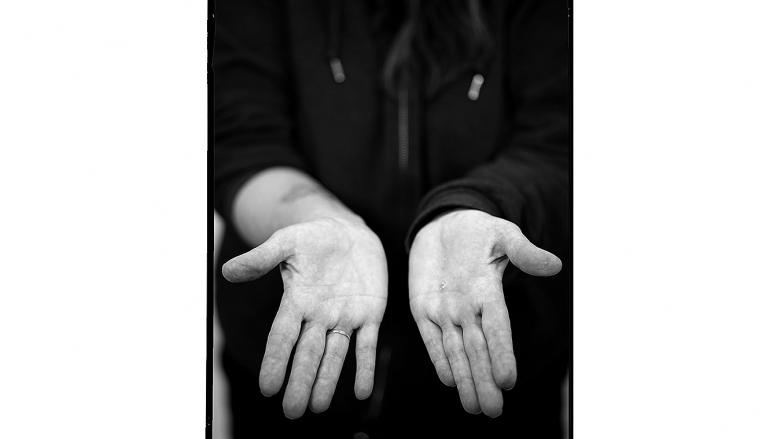 Hands of BART track welder Shelley Culloty