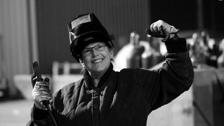 BART track welder Shelley Culloty strikes a Wendy Welder pose