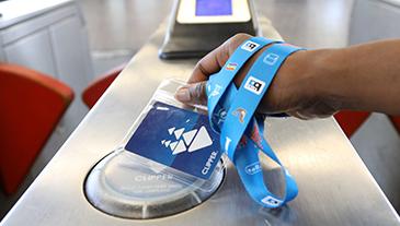 Someone tagging a clipper card at a fare gate