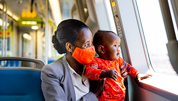 A mother and child on board a new BART train.